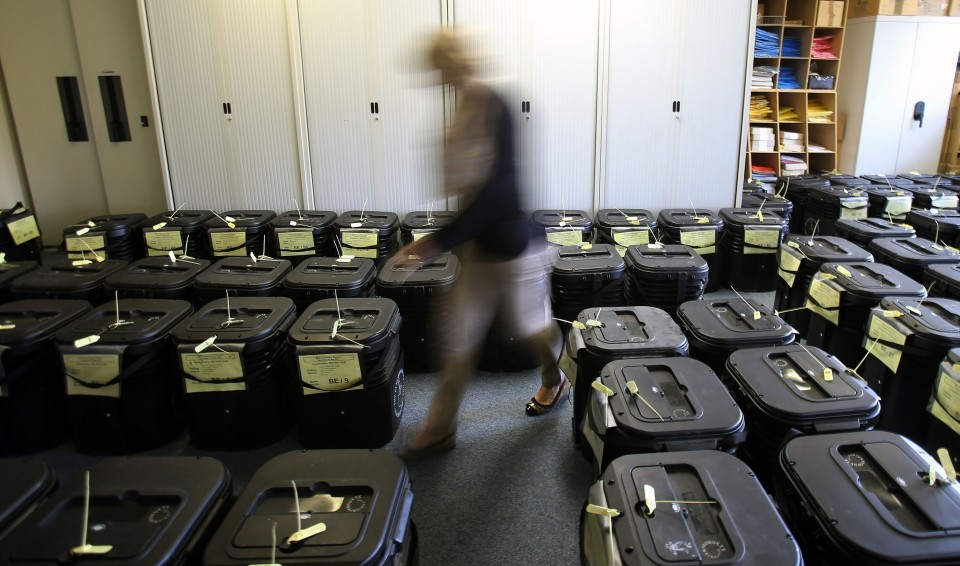 Ballot boxes are tallied and stored ready for delivery to polling stations for tomorrow's General Election vote at the Newtownards Electoral office in Co Down Northern Ireland.