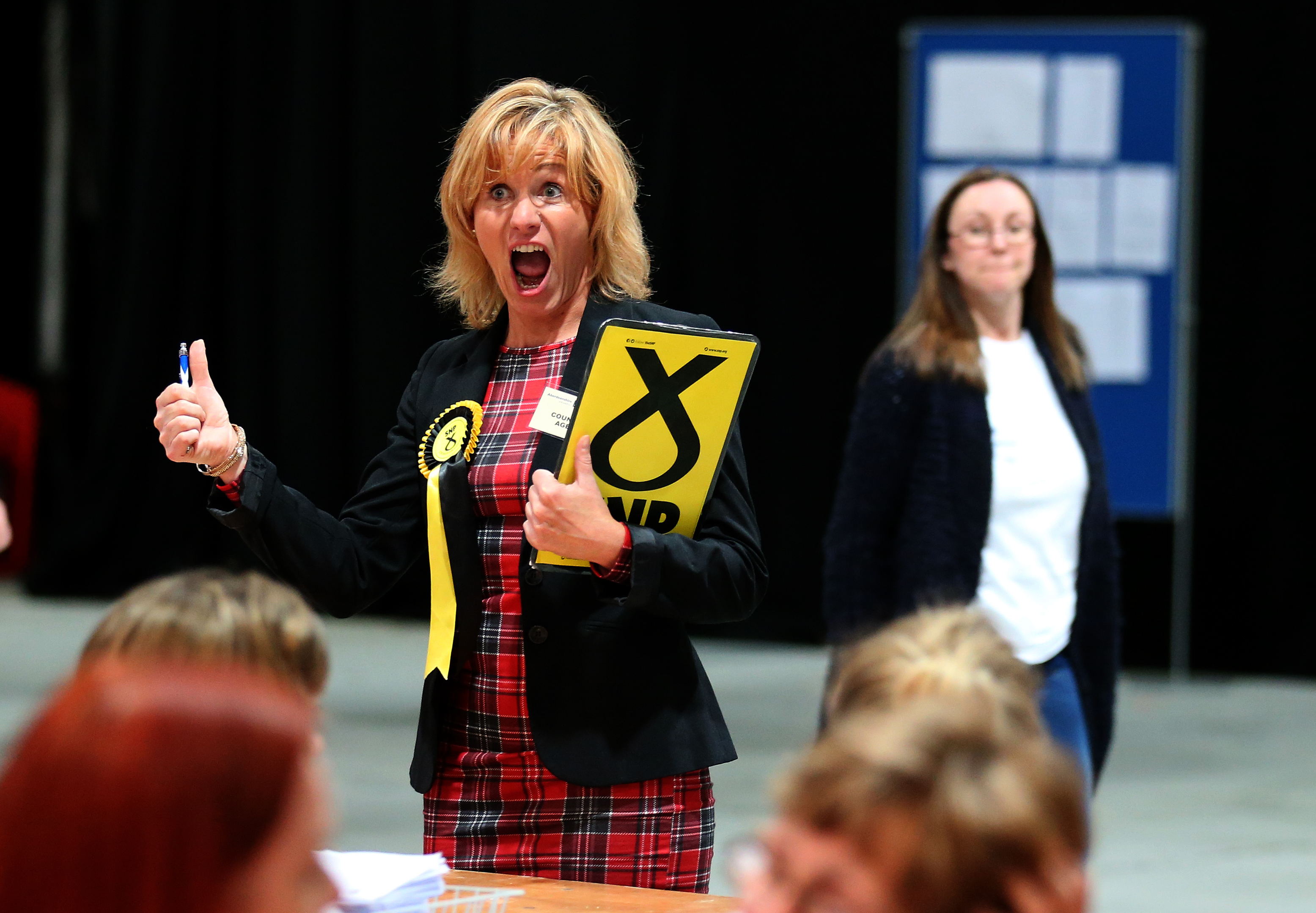 An SNP election canvasser gives the thumbs up as she views ballot papers being counted for the Banff and Buchan, Gordon and West Aberdeenshire and Kincardine constituency counts in the General Election at the Aberdeen Exhibition and Conference Centre in Aberdeen.