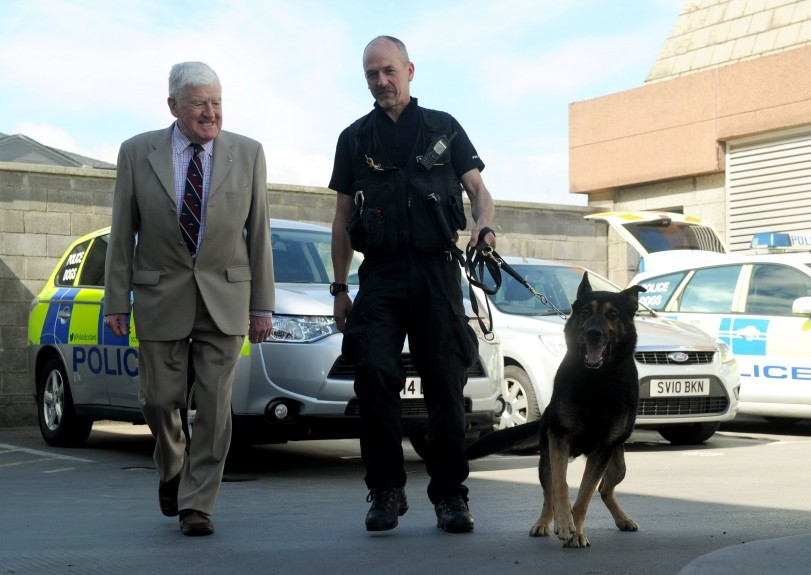 Dog handler Colin Hunter is retiring after 30 years.  Colin is pictured with Grampian's first ever dog handler Sandy Reid,