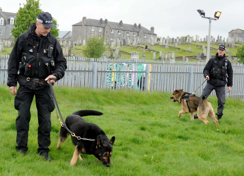 Police Scotland attend the Aberdeen and Celtic match at Pittodrie, Aberdeen. In the picture are Pc Colin Hunter, left and sergeant, Dave MacKinnon, Police dog unit.