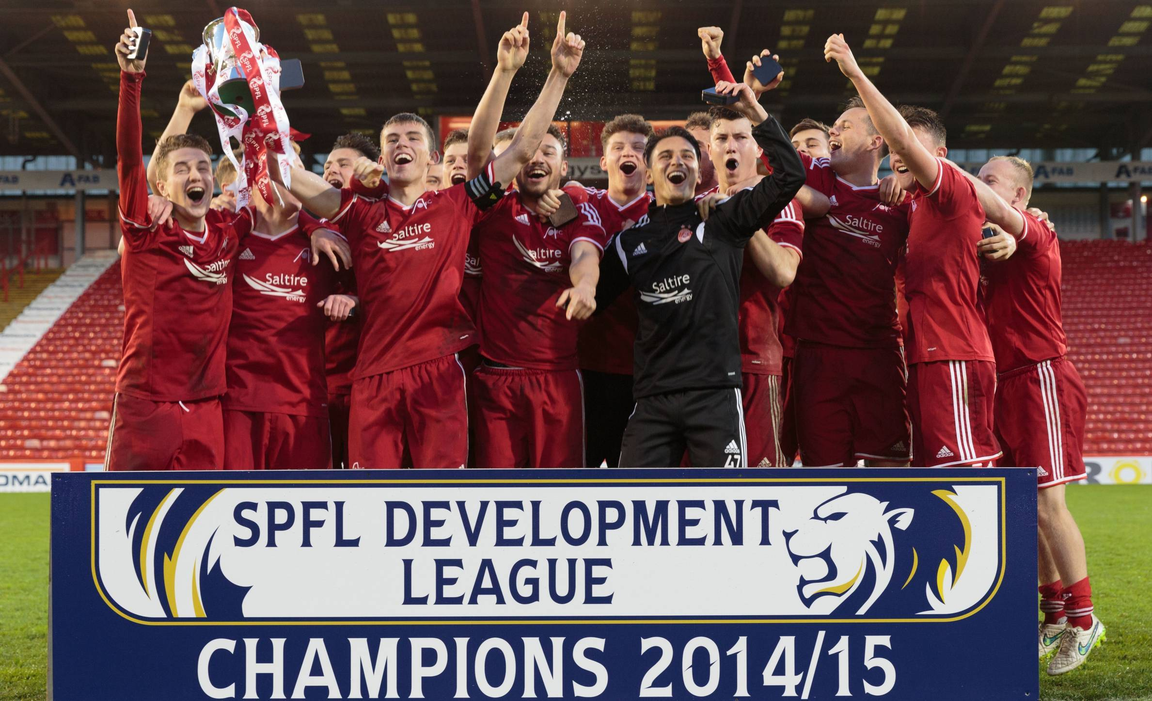 Aberdeen U20's celebrate after winning the SPFL Development League.