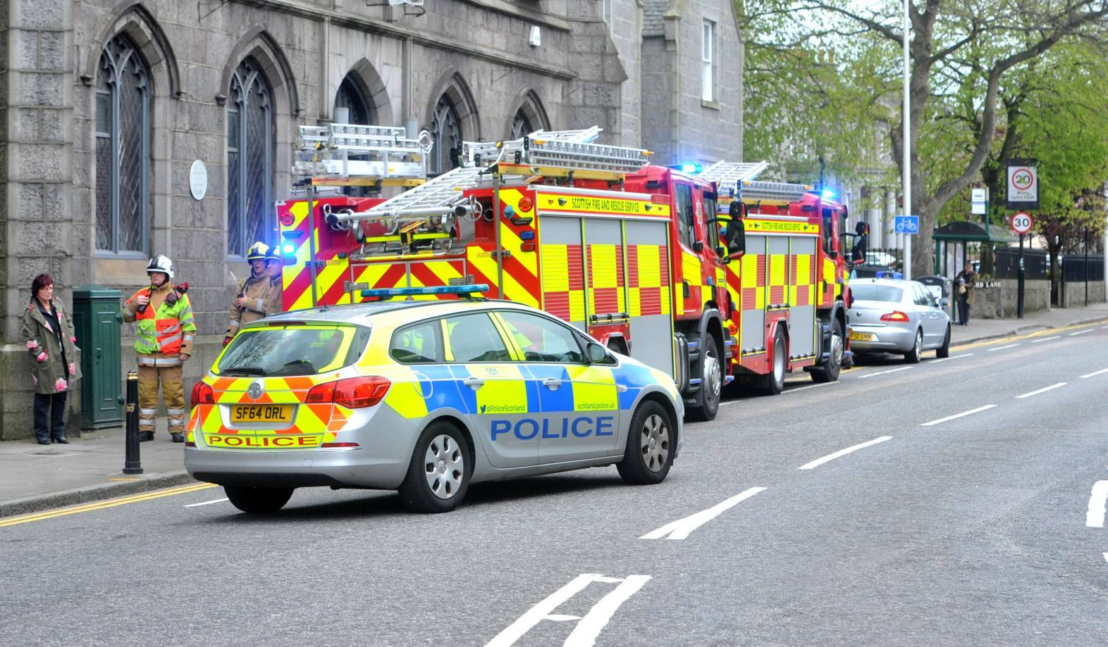 Police and firefighters at the scene in Alford Place today