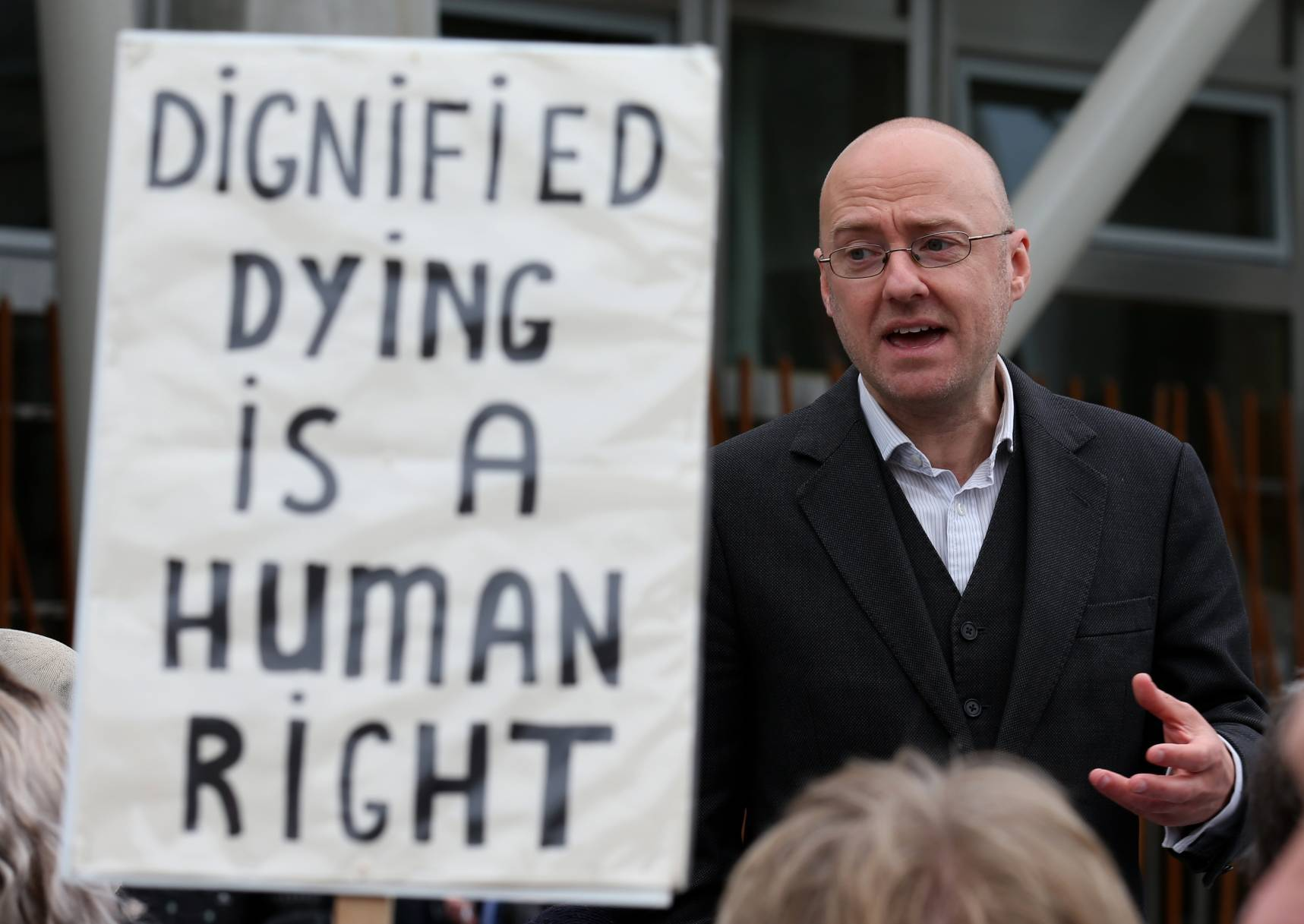 Assisted Suicide Bill supporter Patrick Harvie speaks with representatives of My Life, My Death, My Choice, outside the Scottish Parliament