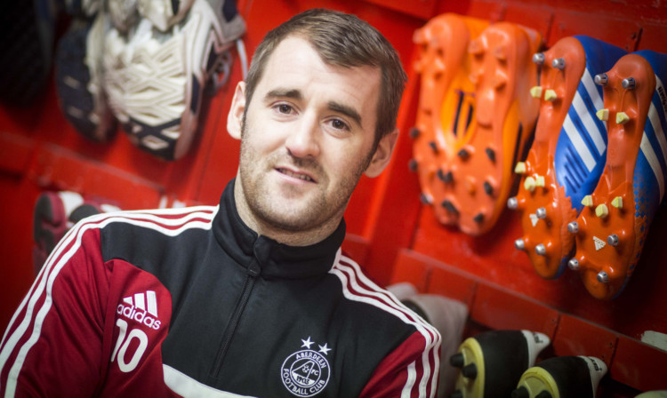 Niall McGinn has been called up to the Northern Ireland squad for the Qatar and Romania games.