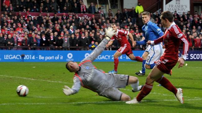 Peter Pawlett scores Aberdeen's second against St Johnstone in the 2014 League Cup semi-final. (Picture by Richard Frew.)