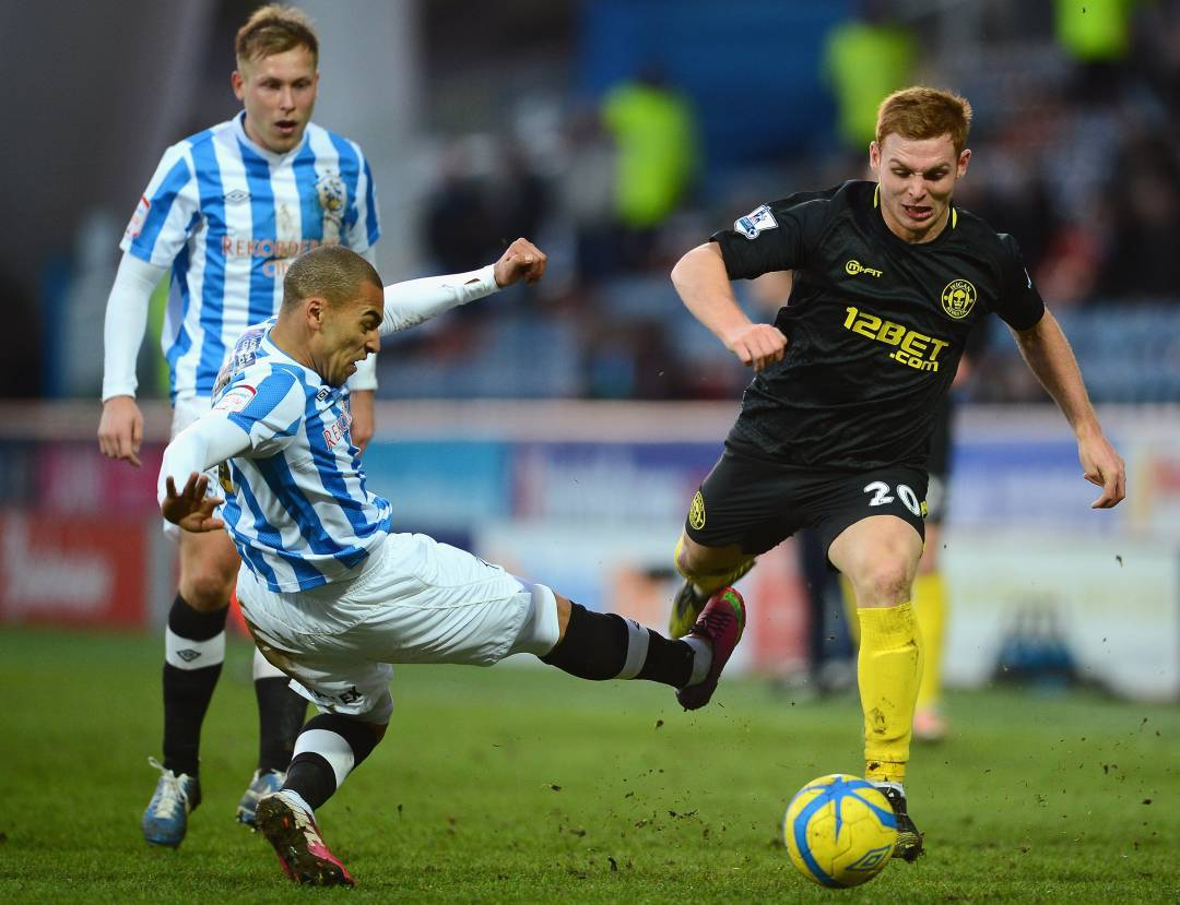 Fyvie, right, in action for Wigan.