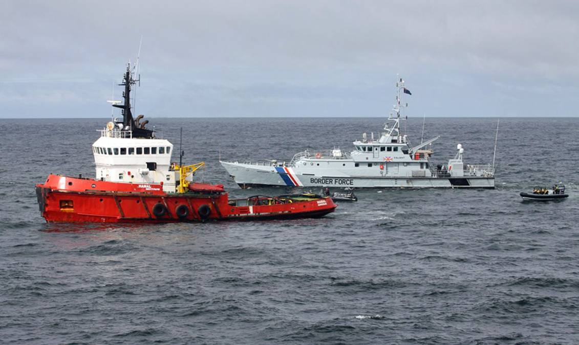 The Royal Navy and UK Border Agency intercepted the boat off the coast of Aberdeen.