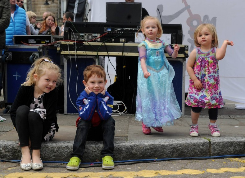 Enjoying the music on the high street are, from left: Ellis Riley, Austin Ash, Aimee Ash and Sophie Ash.