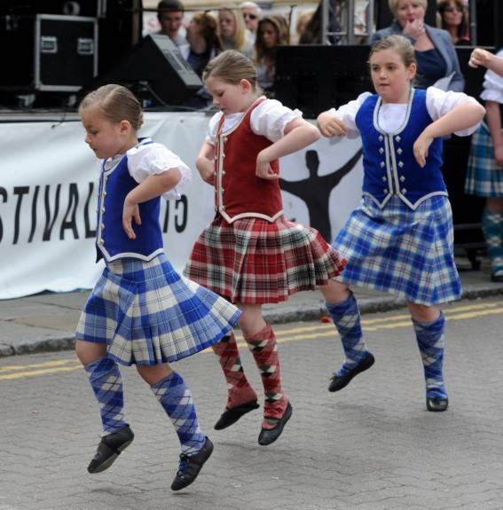 Highland dancers  perform on the High Street.