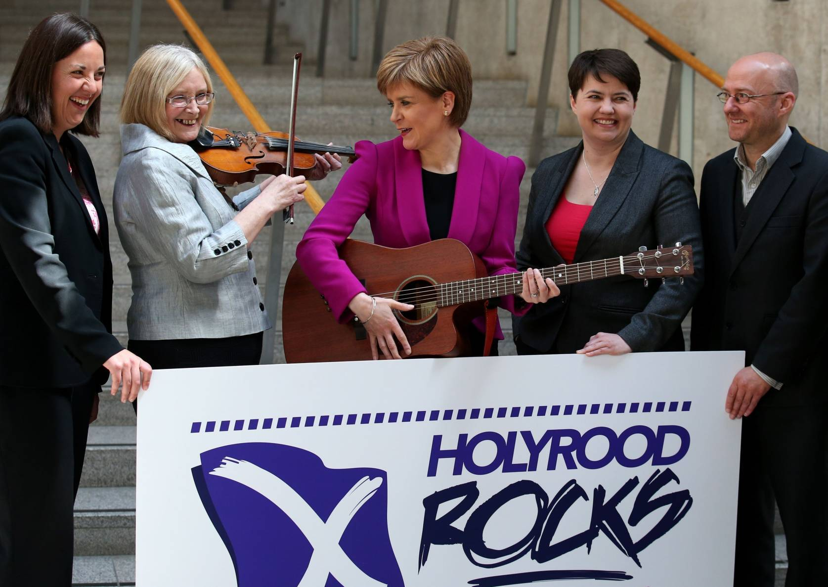 First Minister Nicola Sturgeon (centre) and Presiding Officer Tricia Marwick(second left) join Scottish Labour leader in the Scottish Parliament Kezia Dugdale (far left) Scottish Conservative leader Ruth Davidson (third right), Scottish Green Party leader Patrick Harvie (right), as they launch Holyrood Rocks