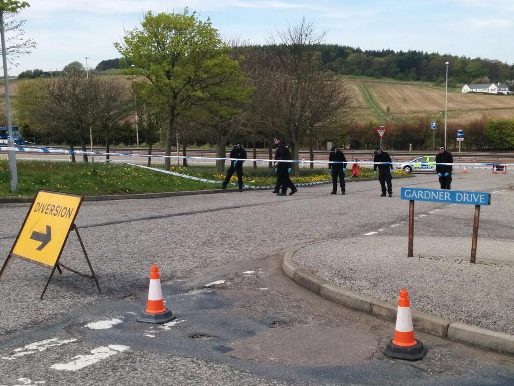 Police searching the area on Nigg Way.