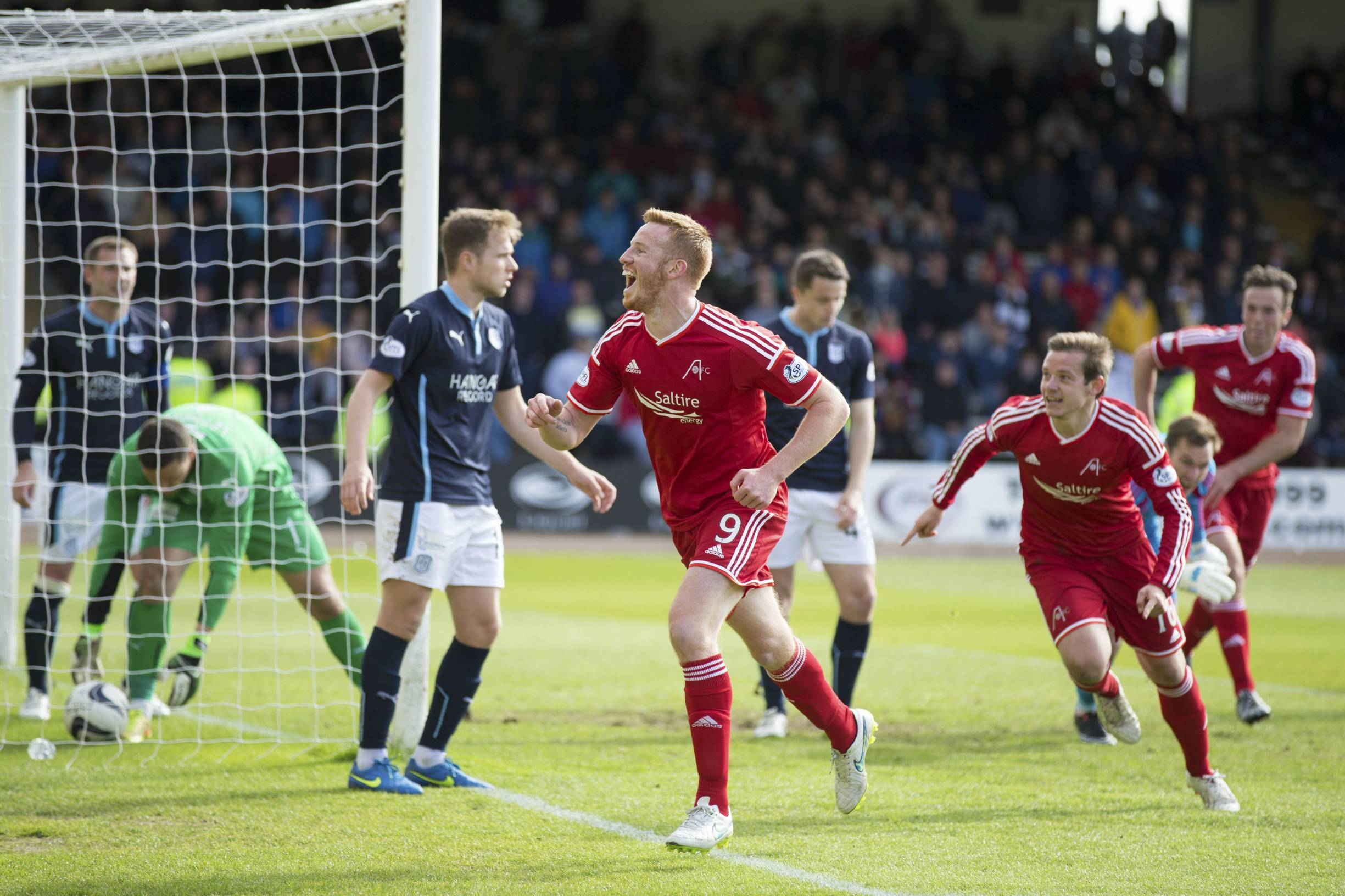 Adam Rooney celebrates after equalising for his side.