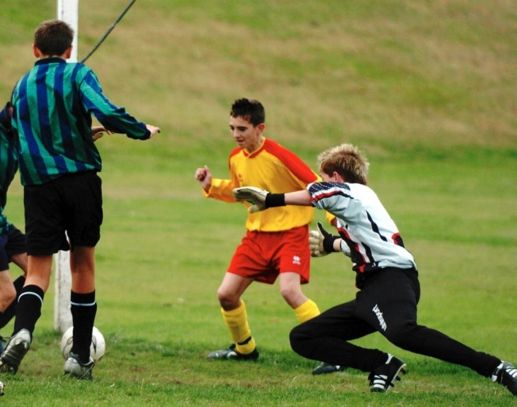 2005: Steven Haldane, left, of Hazlehead, and Graeme Shinnie, of Kincorth, centre, with Kincorth keeper, Neil Walker coming in to save the ball.