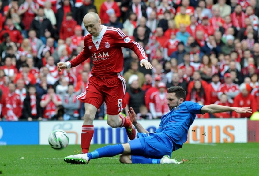 Shinnie played against the Dons in last year's Scottish League Cup final at Parkhead.