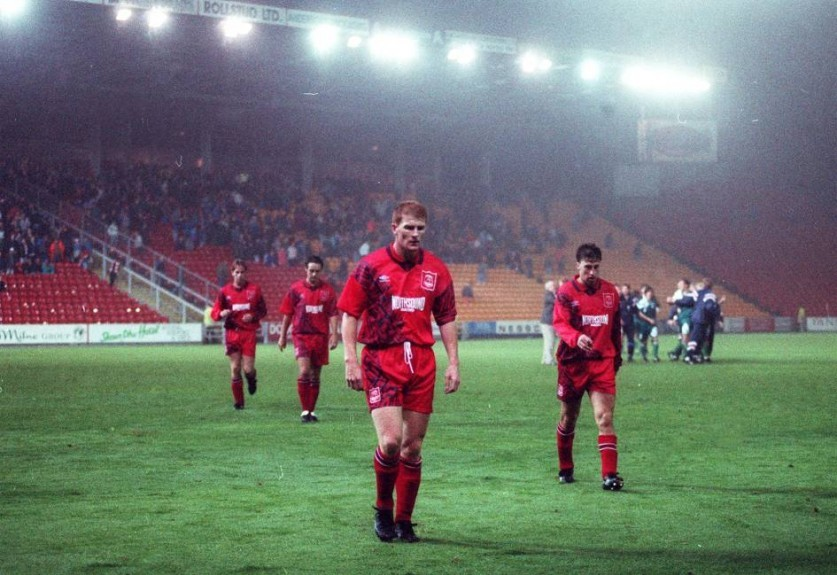 Duncan Shearer, front, and Paul Kane, right, bow their heads as they walk from the pitch after being knocked out by Skonto Riga in August 1994, on the away goal rule.
