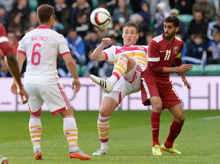 Scotland's Craig Forsyth gets the better of Hassan Khalid H Alhaydos (right)