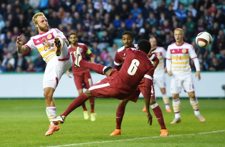 Scotland striker Johnny Russell (left) goes close