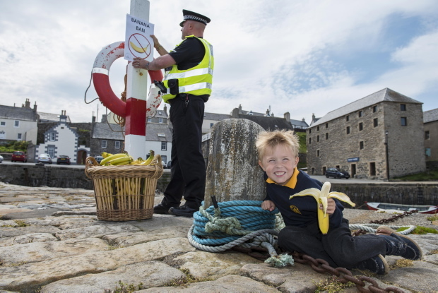 Pc Malcolm Smith is ready to enforce Portsoy's banana ban ahead of the Scottish Traditional Boat Festival, but it seems Mason Taylor, 6, isn't quite ready to give up his favourite fruit.