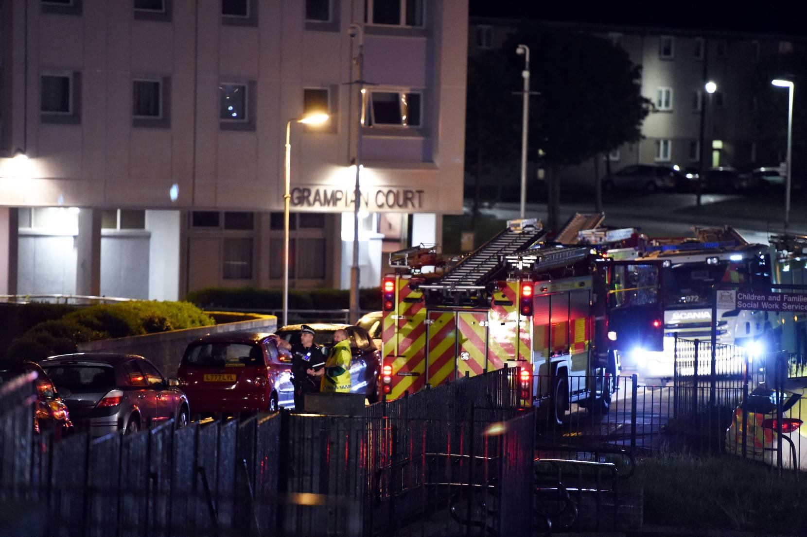 A total of 21 people required treatment from paramedics after a fire at Balnagask Circle in Aberdeen. Emergency services are pictured at the scene.