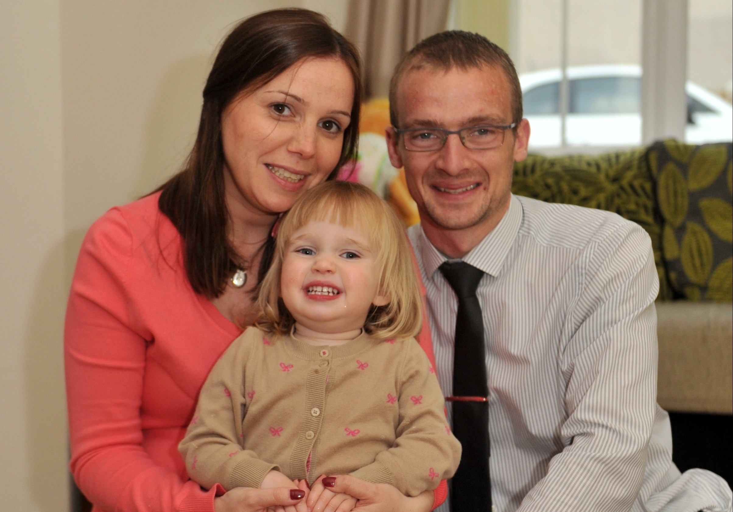 CHARITY CHAMPIONS: Anna and Jonathan Cordiner at home in Oldmeldrum with their two-year-old daughter Charlotte.