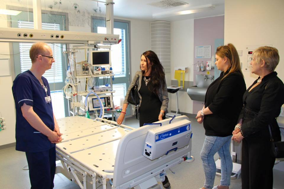 THANKFUL:  Emma, centre,  revisits the intensive care unit and speaks to acting nurse manager Steve Marjoribanks, left.