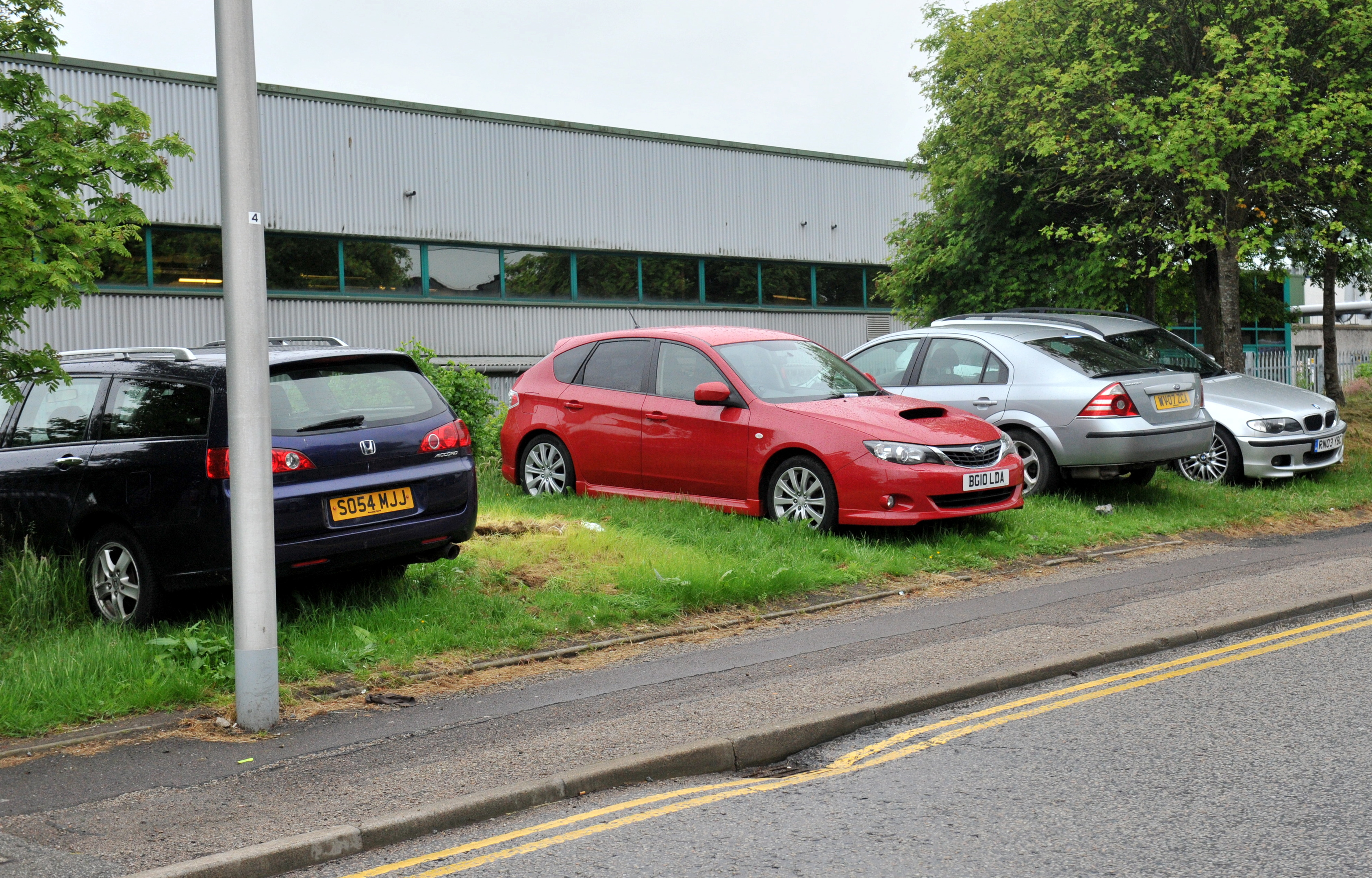 Some cars  –  not the ones pictured  –  are said to be left for up to a month on Kirkhill Drive's verges.