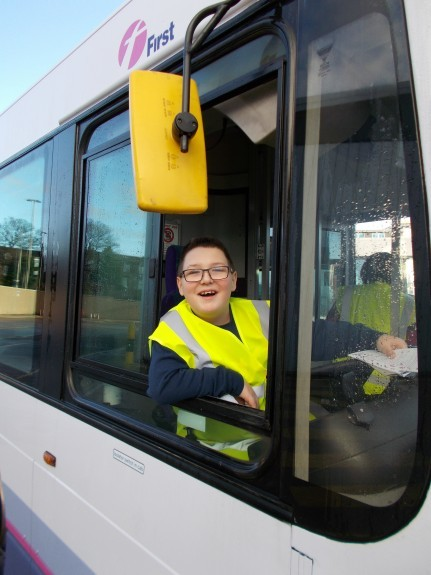 Logan at the wheel of a First Bus.