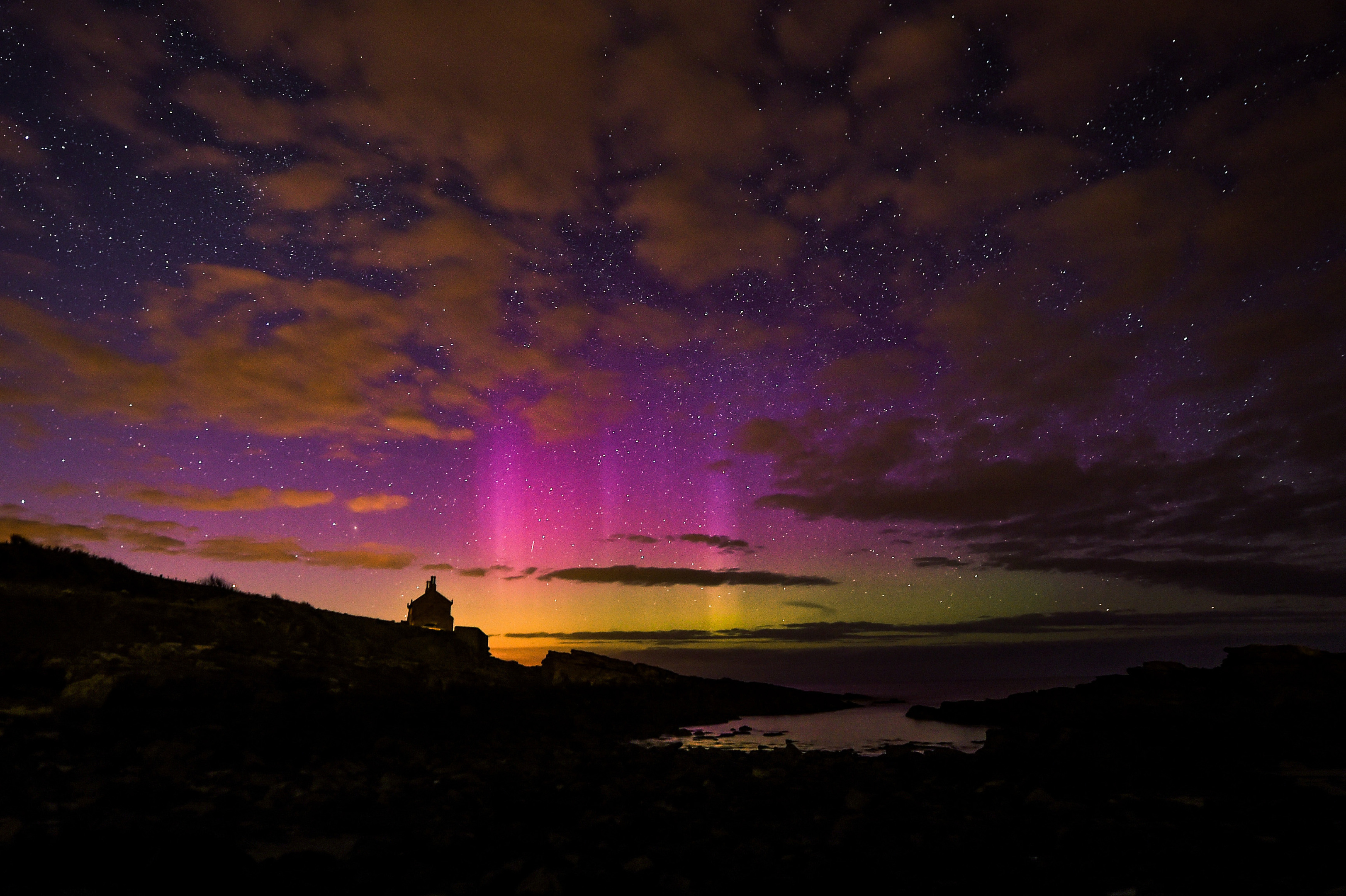 The aurora borealis, or the northern lights as they are commonly known, takes place over the Bathing House in Howick.