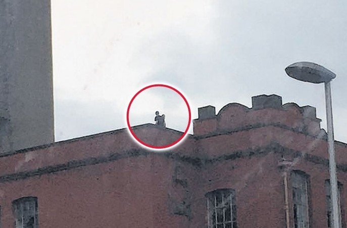 Unidentified figures on the roof of the former Broadford Works factory in Aberdeen