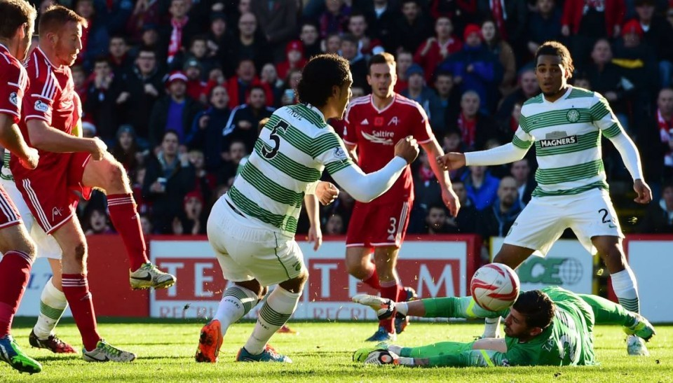 Adam Rooney scores against Celtic in the Dons' 2-1 defeat at Pittodrie last year.