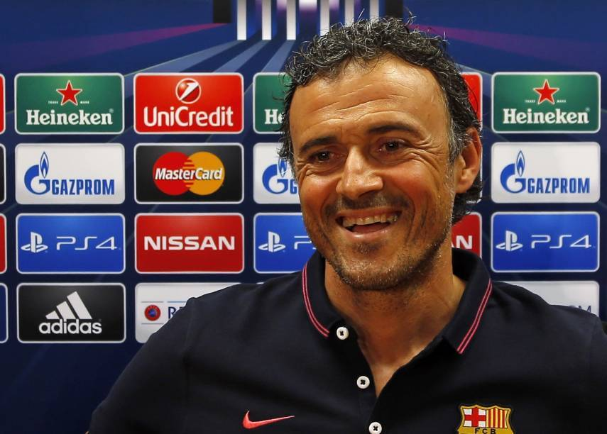 Barcelonaís head coach Luis Enrique smiles during a press conference after a training session ahead of Saturday's Champions League final soccer match against Juventus.
