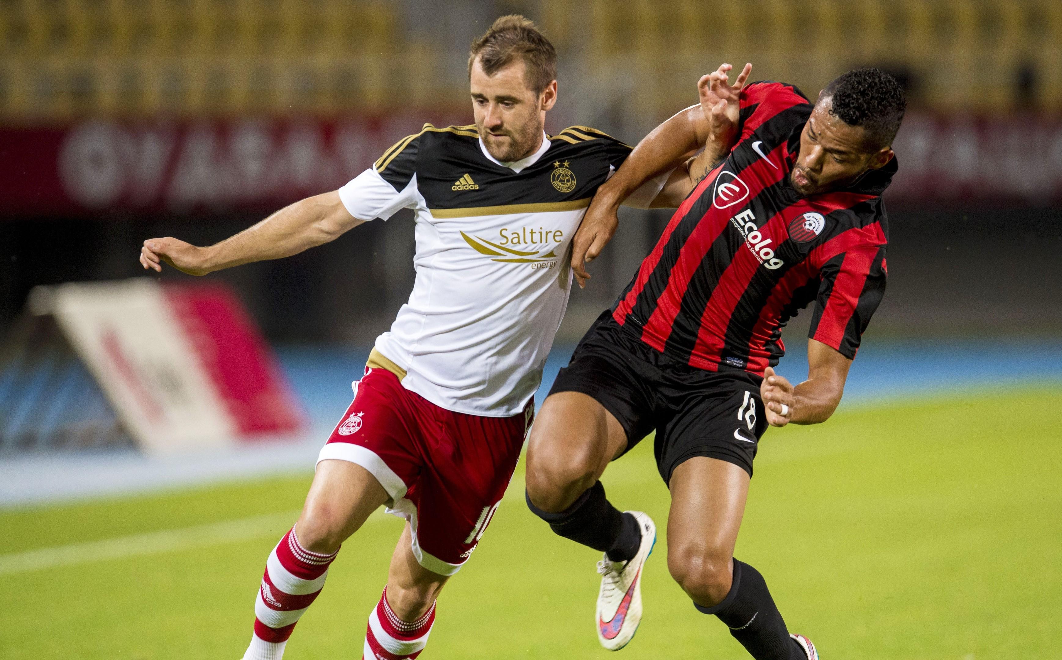 Aberdeen's Niall McGinn (left) battles with Stenio Junior.