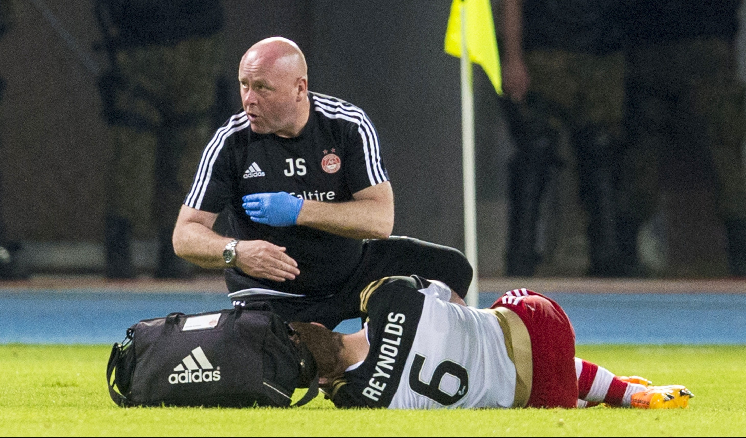 The team physio signals to the bench after Aberdeen's Mark Reynolds picks up an injury.