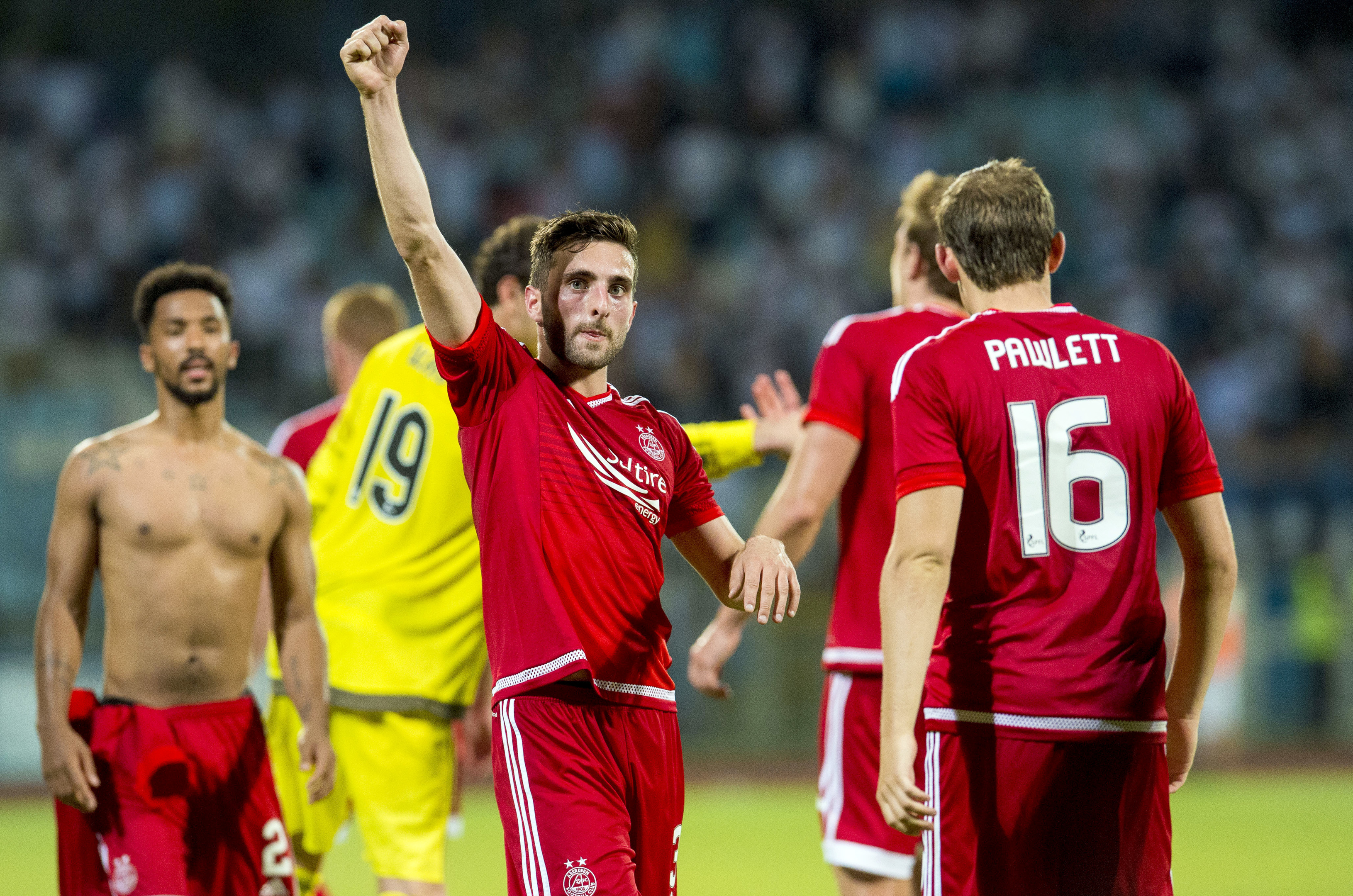 Aberdeen's Greame Shinnie salutes the travelling fans