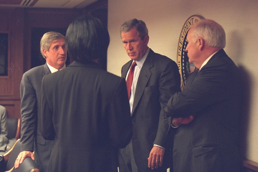 George Bush is briefed by Dick Cheney and his senior staff after arriving at the White House.