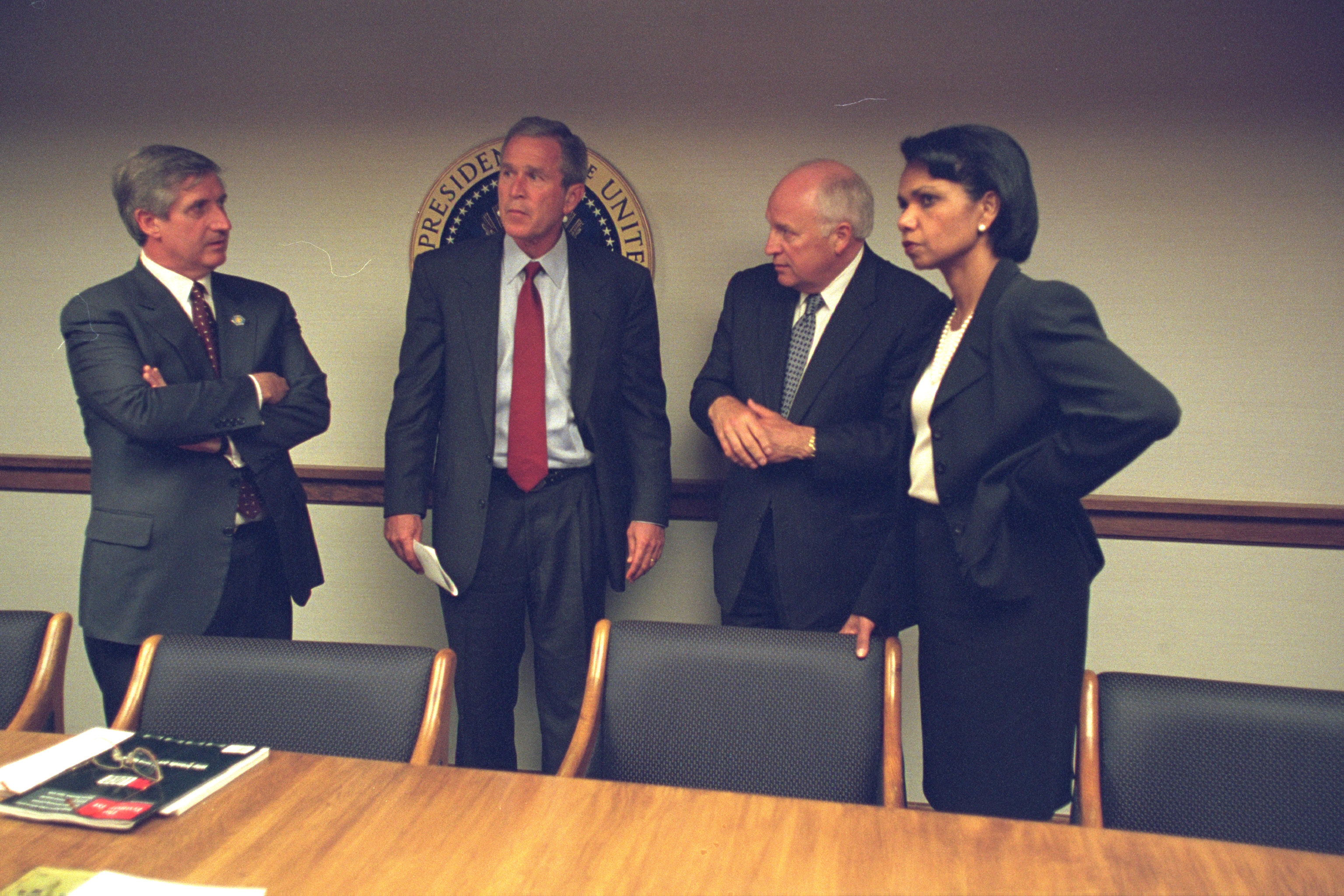 President George Bush is briefed on the situation after arriving at the White House.