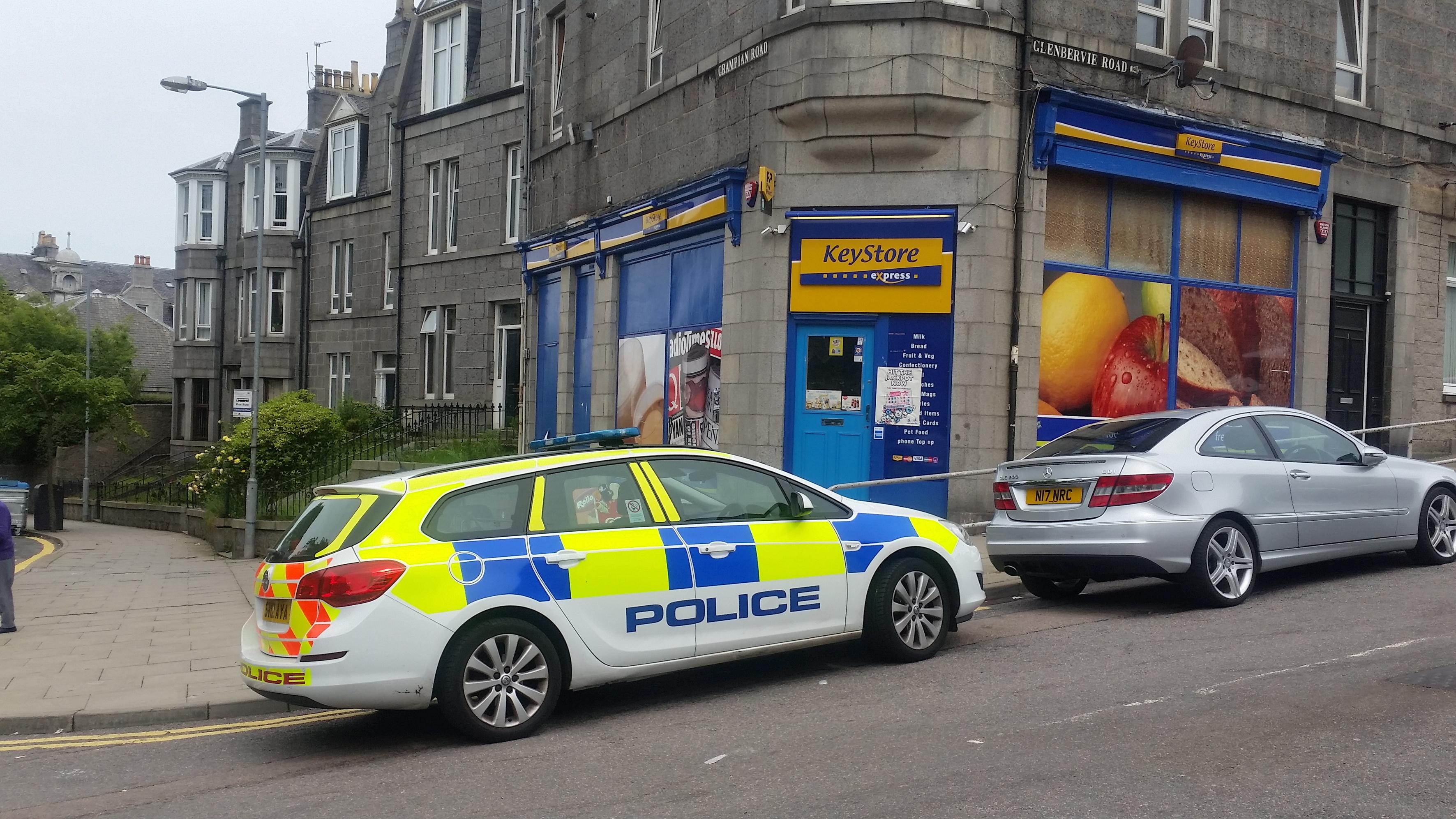 Police near the scene on Grampian Road.