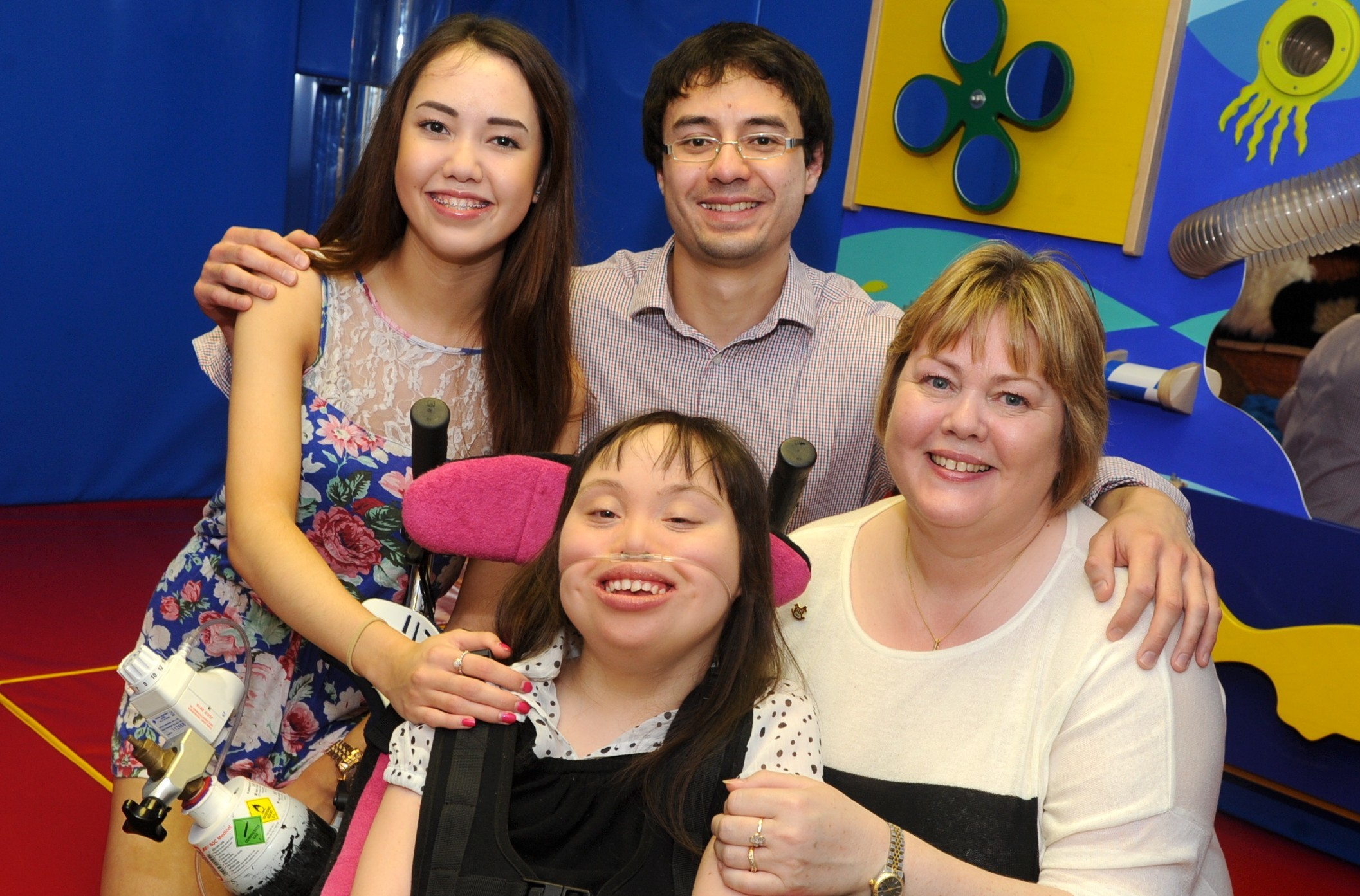 Sammy Ho, front centre, with mum Irene, right, and brother and sister Steven and Natalie.  Picture by Chris Sumner