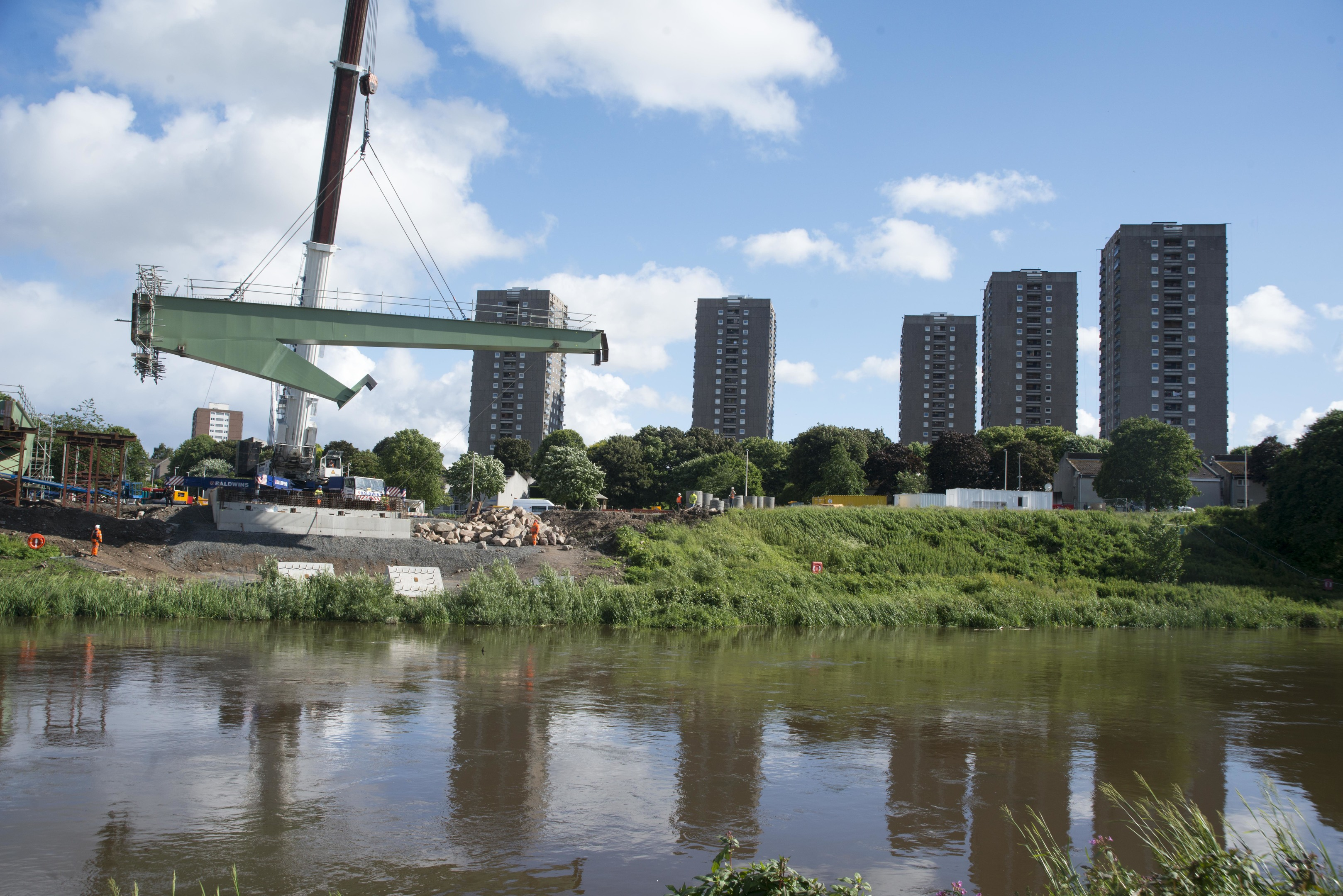 Delicate work as the part hovers high over the River Don.  Pictures by Norman Adams/Aberdeen City Council.
