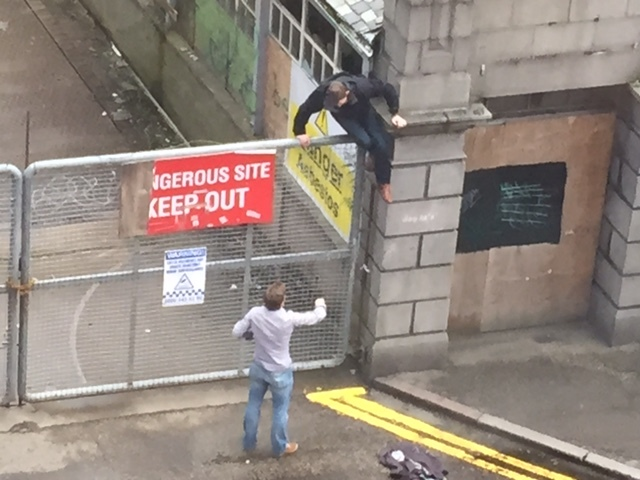 A man climbs on the Broadford Works fence