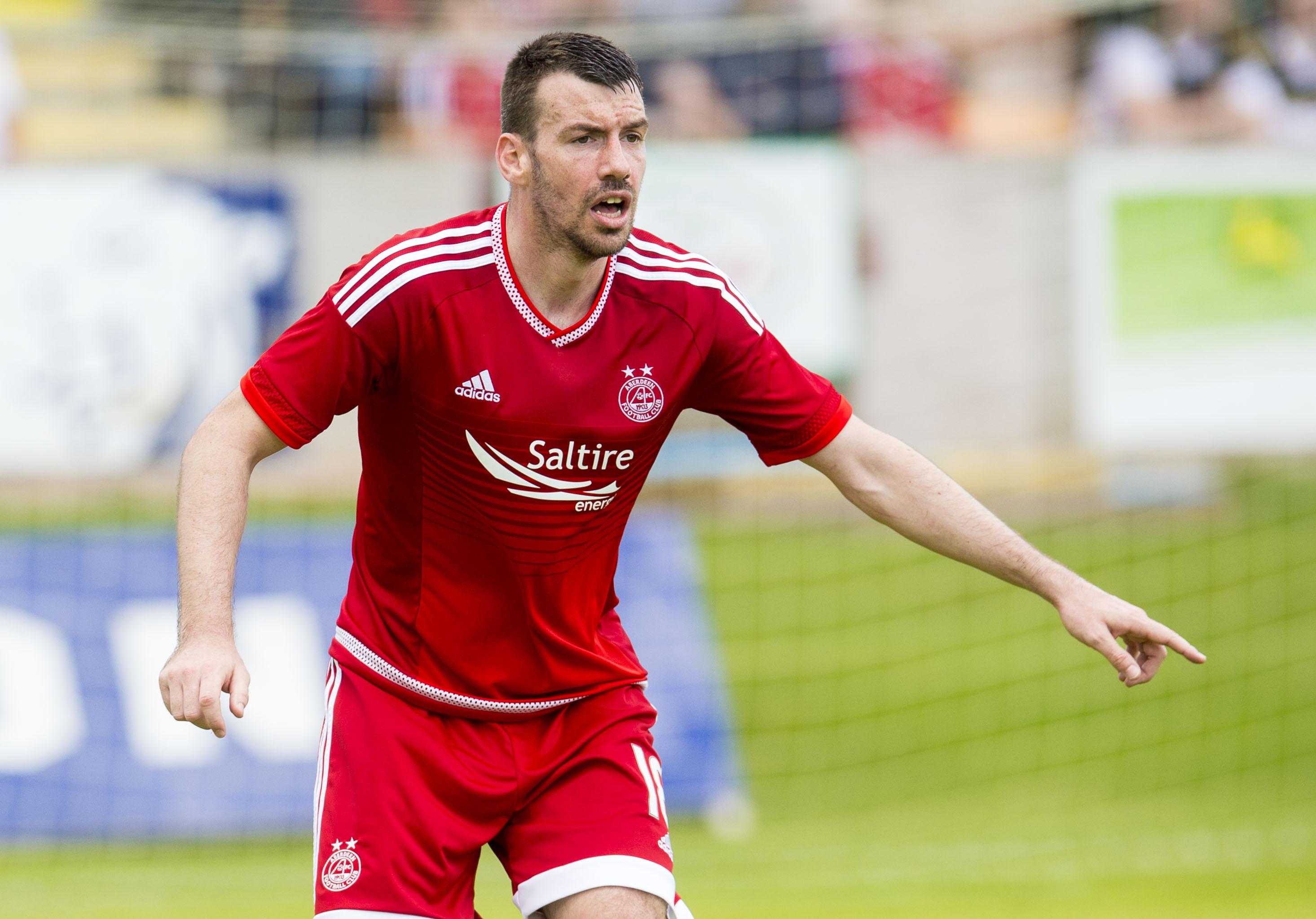 POINTING THE WAY:  Aberdeen defender Paul Quinn.
