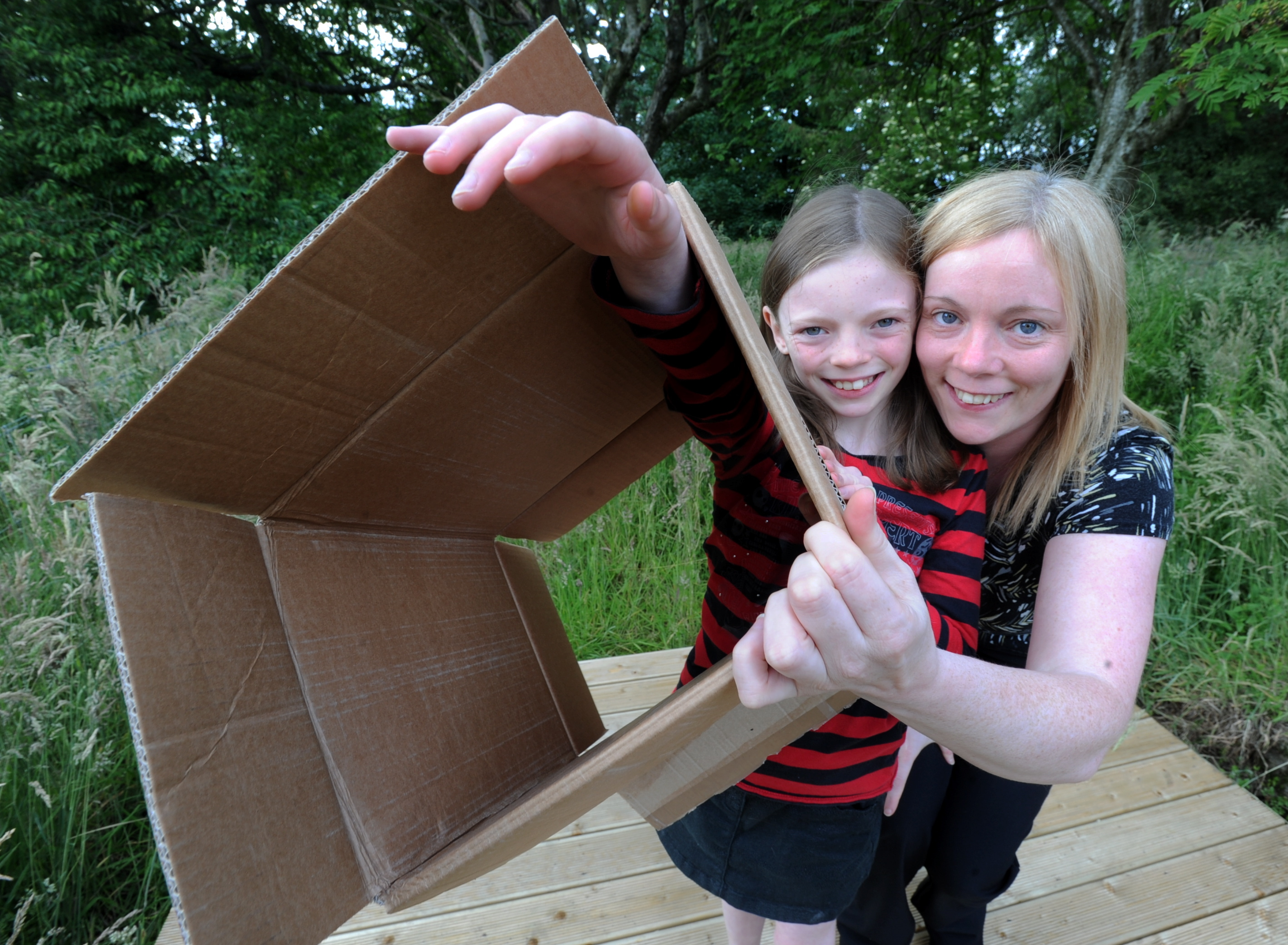 A box of 'nothing' for Ashley Fagan, left, who wants money to be donated to The ARCHIE Foundation instead of receiving birthday presents, pictured with her mum Catherine.