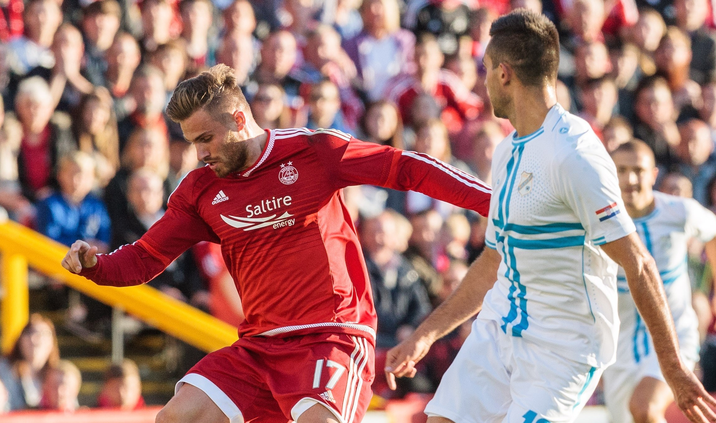 David Goodwillie  goes past a Rijeka player at  Pittodrie.