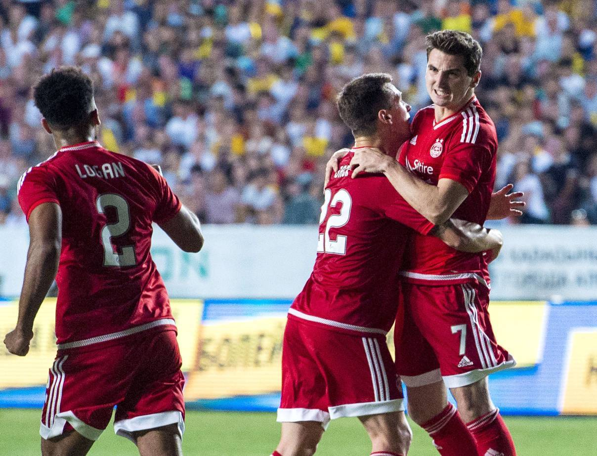 Kenny McLean (right) celebrates pulling a goal back for Aberdeen.