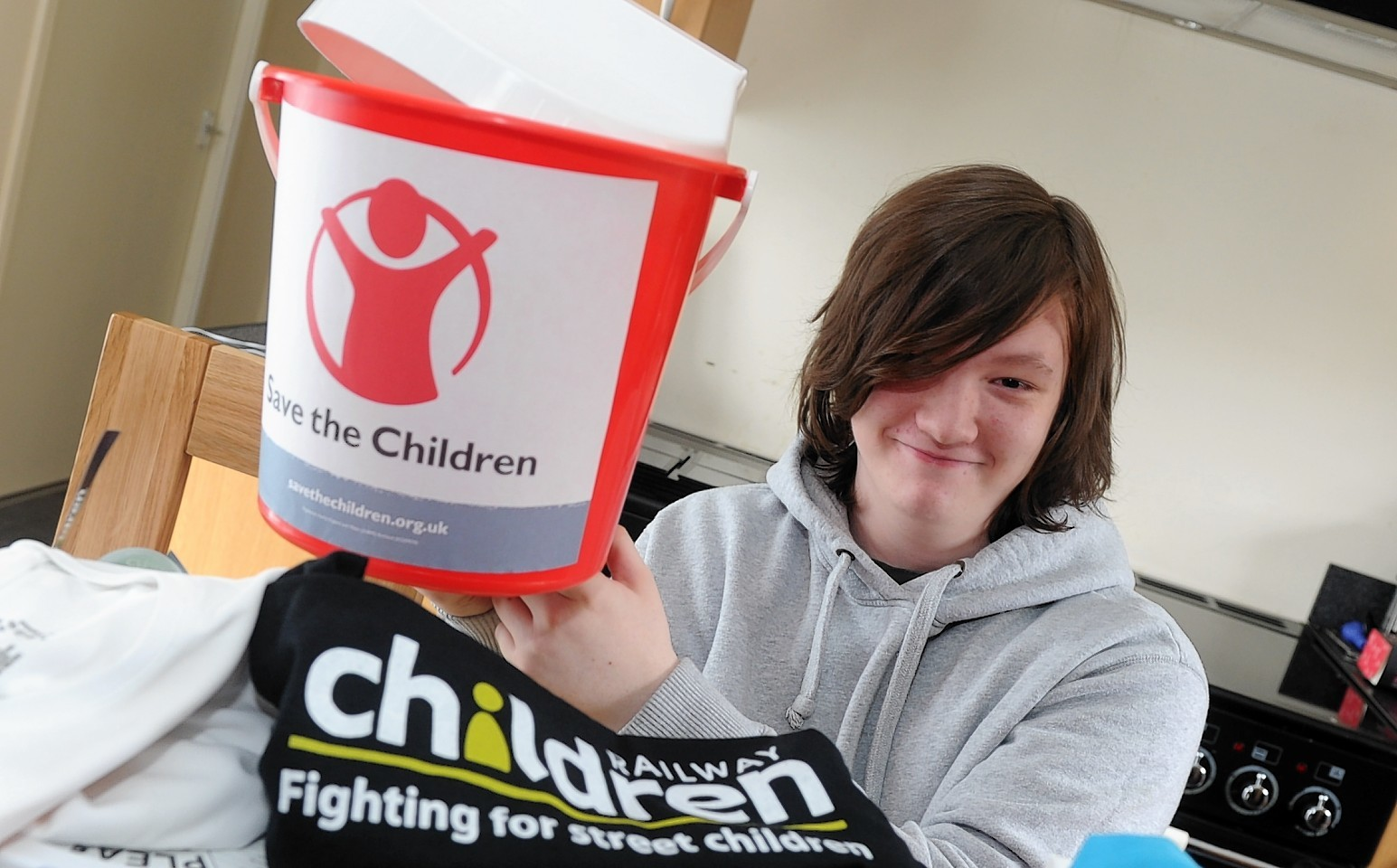 Brandon Cran is to collect cash for charity in a bucket on Union Street.  Picture by Chris Sumner