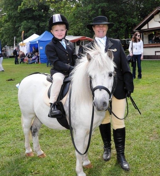 Stewart Sweeney with his mum Heather Sweeney and their pony Harley.