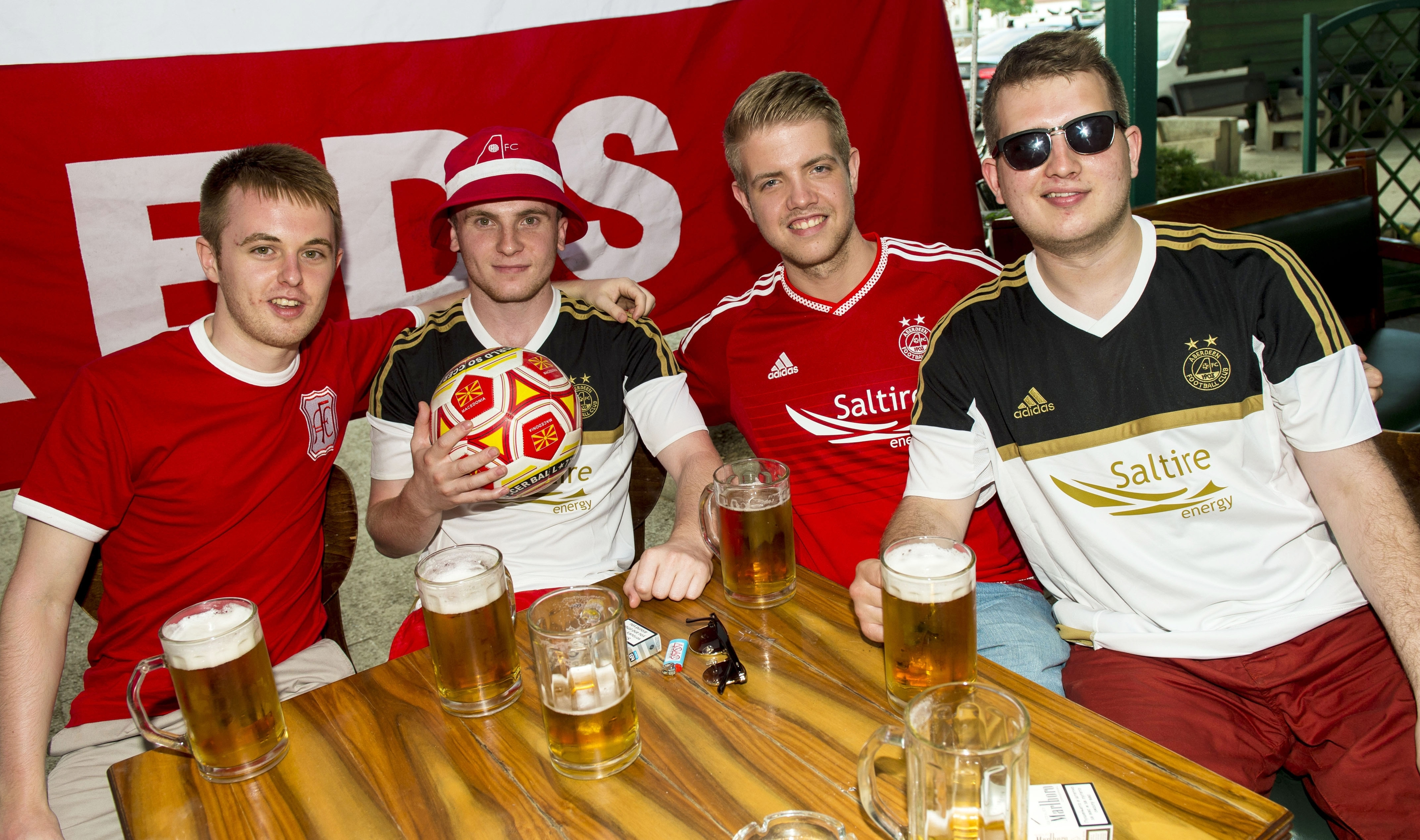 The Aberdeen fans prepare for the match