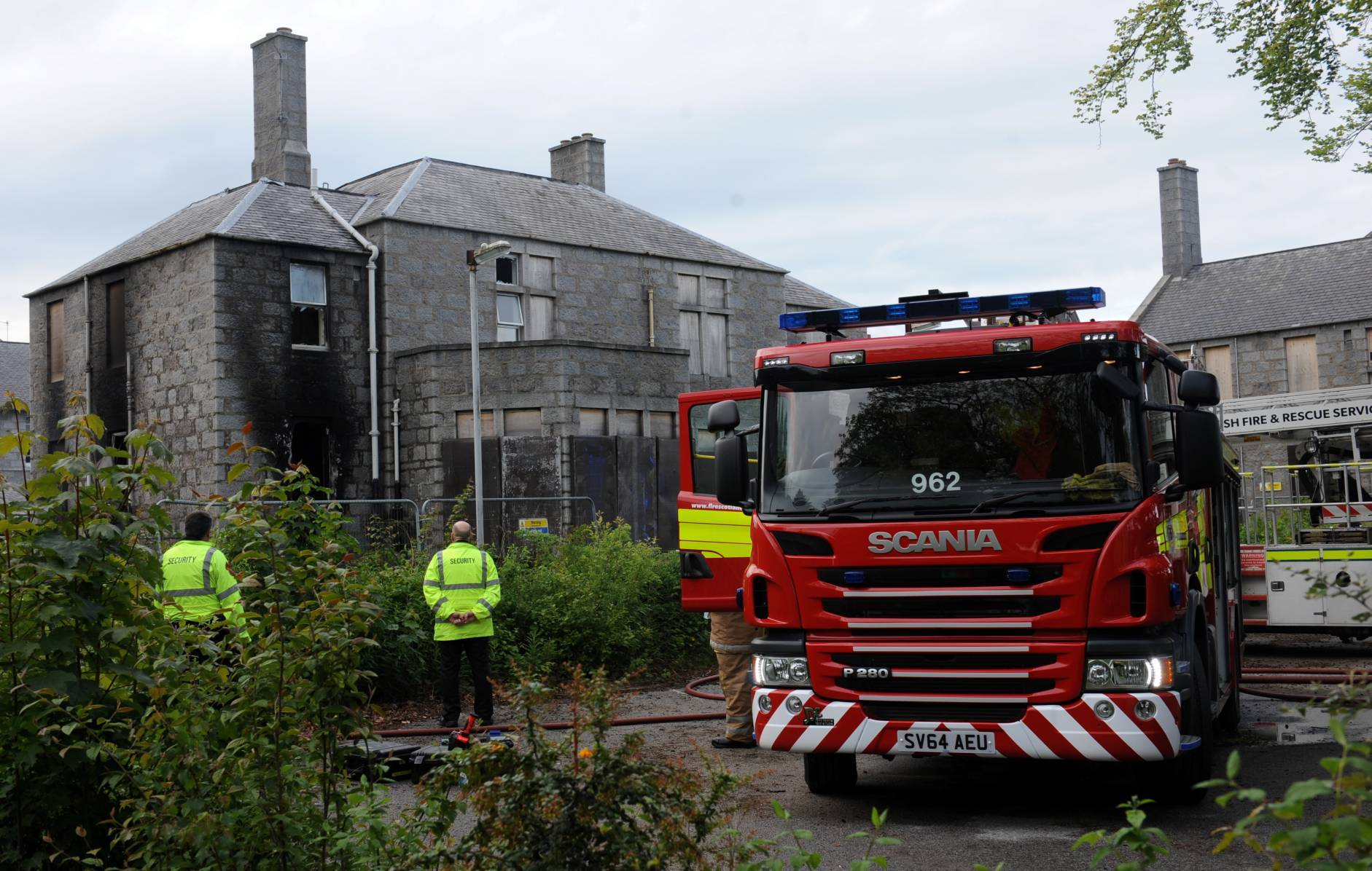 Firefighters at the scene of the blaze in an old section of Cornhill Hospital.