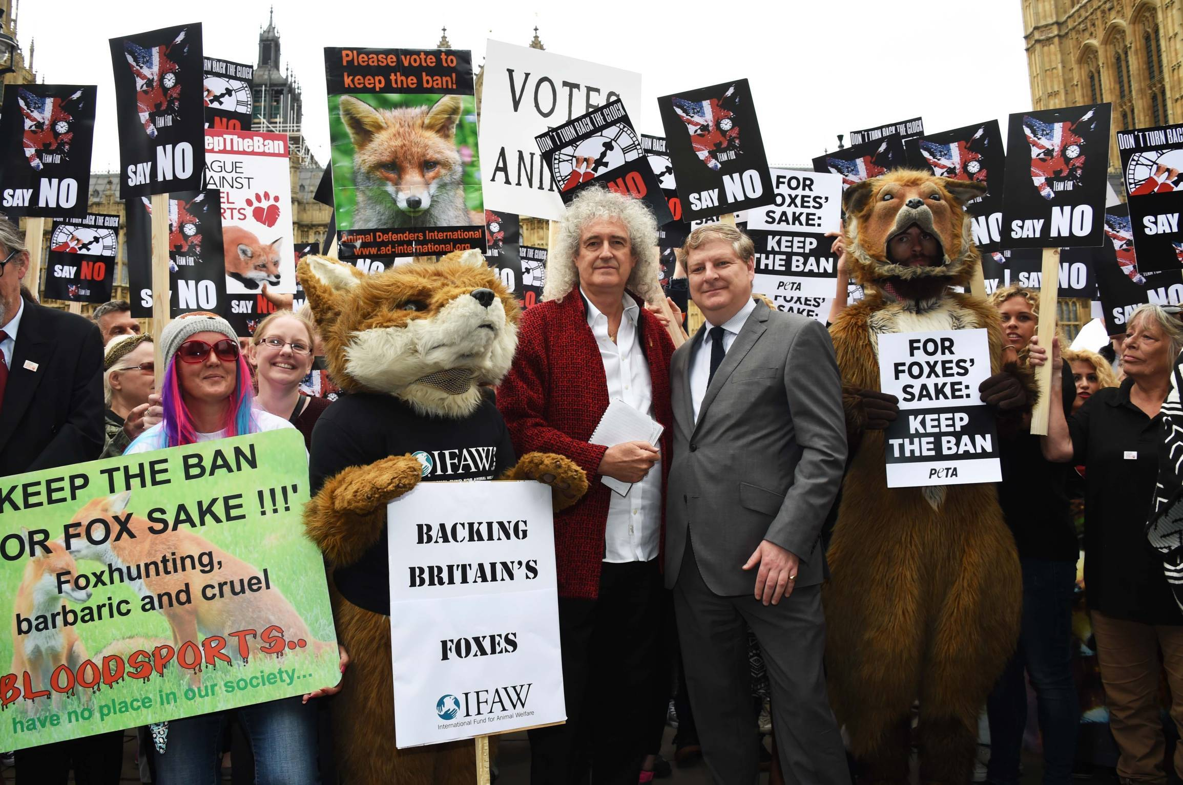 Brian May and Angus Robertson from the SNP speak during an anti-fox hunting rally for PETA  today