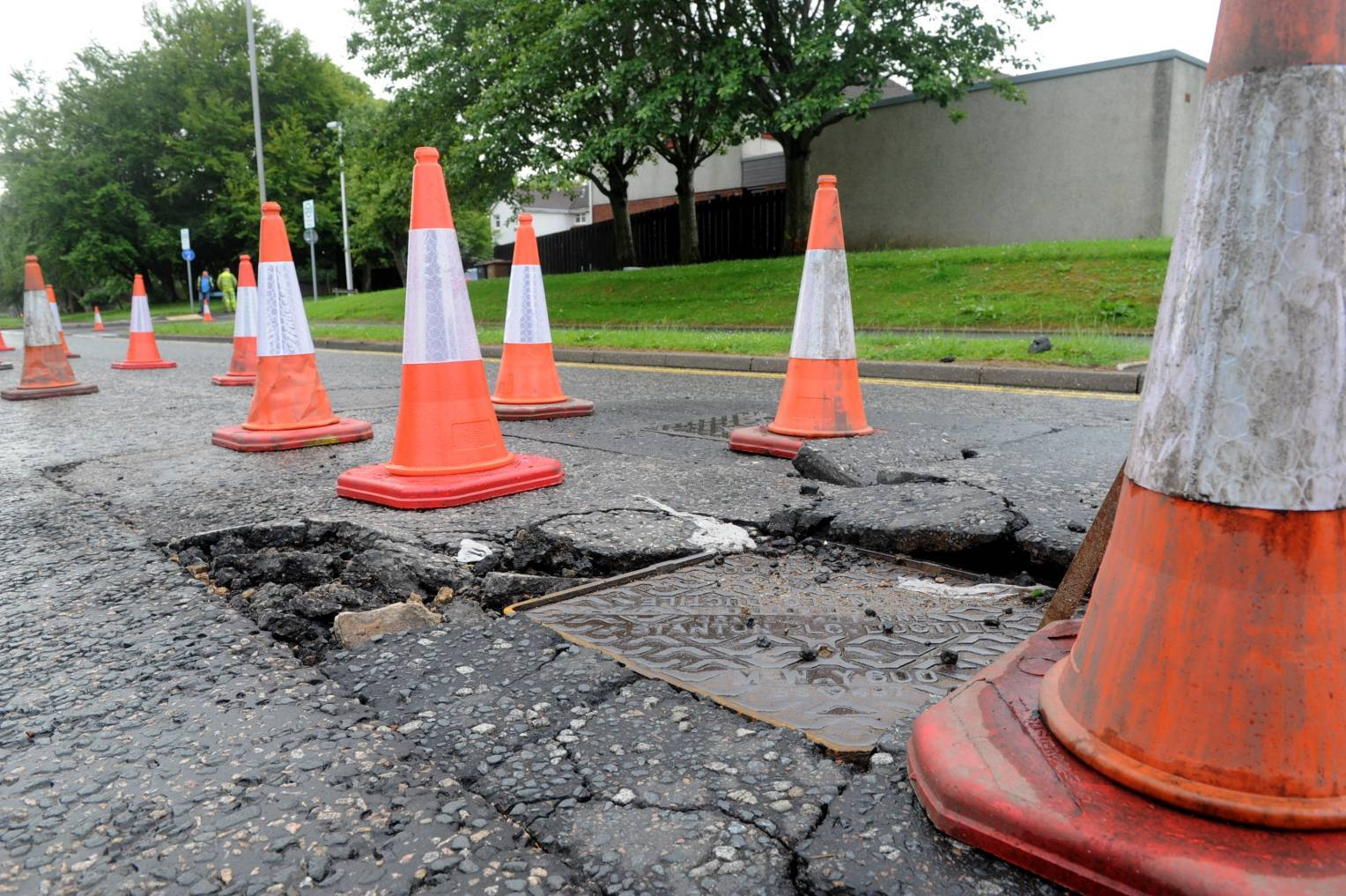 Damage to Jesmond Drive at the junction with Newburgh Drive.